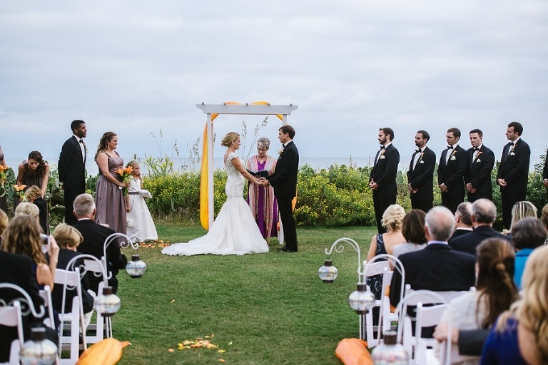 A wedding at the Blockade Runner on the lawn.