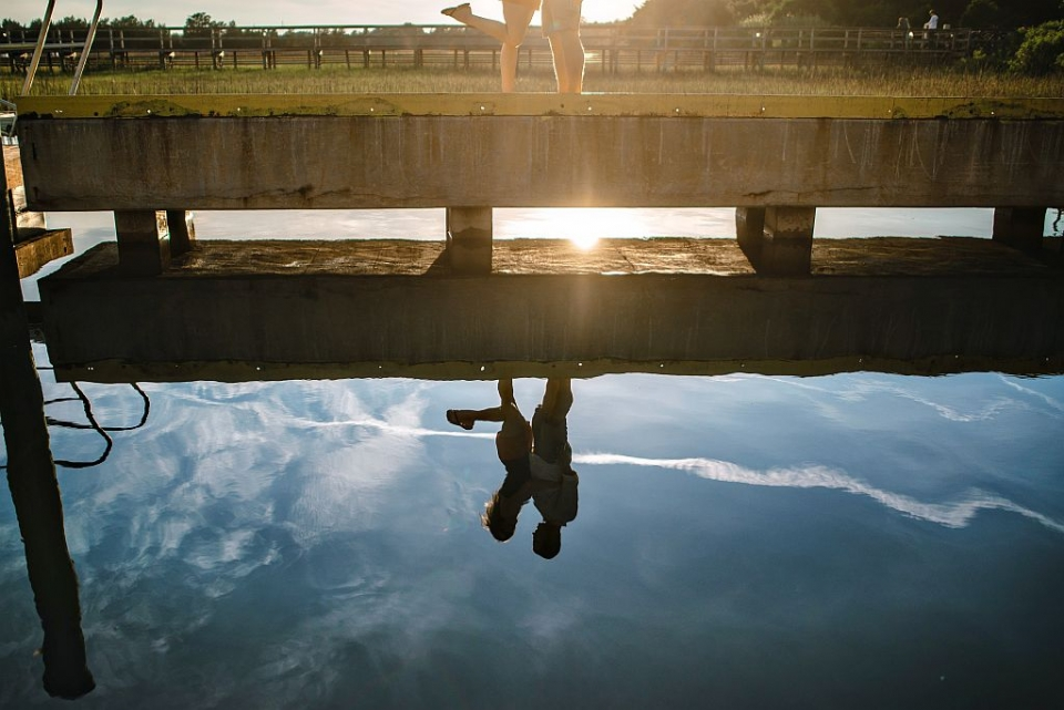 A reflective silhouetteof a couple during a engagement shoot.