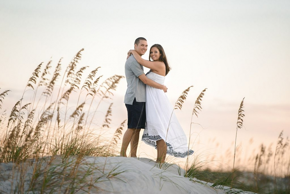 An engagement photo on the beach from Melissa & Adam